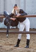 Rider with ammunition and horseshoe — Stock Photo