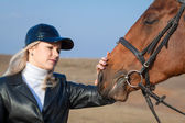 Horsewoman and horse — Stock Photo