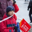 Stock Photo: January 11, 2014, Saratov, Russia. Olympic Torch Relay Sochi 2014. Boy watching transfer of Olympic flame