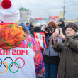 Stock Photo: January 11, 2014, Saratov, Russia. Olympic Torch Relay Sochi 2014. Women photograph member of relay
