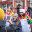 Stock Photo: January 11, 2014, Saratov, Russia. Olympic Torch Relay Sochi 2014. Spectators photographed with member of relay