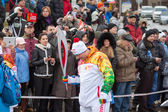January 11, 2014, Saratov, Russia. Olympic Torch Relay Sochi 2014. Member of the relay waits for his turn — Stock Photo