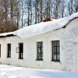 Stock Photo: Old estate with snow on roof