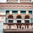 Stock Photo: Wall of old building with balcony