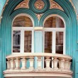 Wall of aged building with balcony — Stock Photo