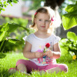 Little blond girl in nature — Foto Stock