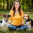 A beautiful woman and his dogs posing outside — Stock Photo #13283887