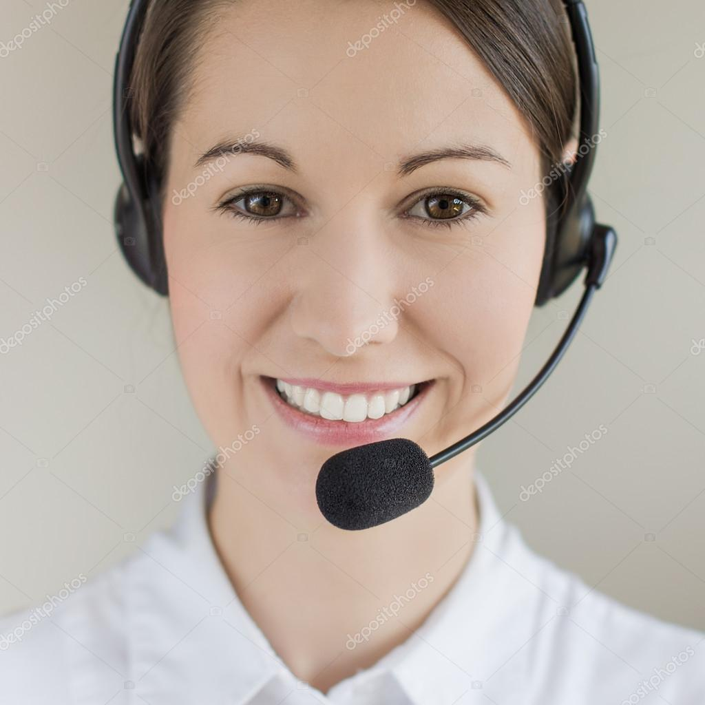 Successful female call centre employee speaking over the headset — Stock Photo #13491707
