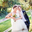 Happy young bride and groom — Stok fotoğraf #13636010