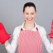 Woman with oven mittens — Stock Photo #16906255