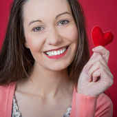 Young woman holds a heart — Stock Photo