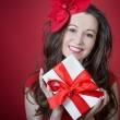 Young woman holding Gift box — Stock Photo #18282079