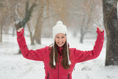 Happy young girl in the snow — Stock Photo