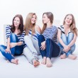 Foto Stock: Group of four beautiful young happy women