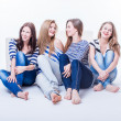 图库照片: Group of four beautiful young happy women