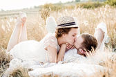 Happy couple embracing and laughing — Stock Photo