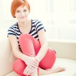 Young woman lying on couch — Stock Photo #23062078