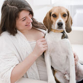 Young woman with her cute beagle — Stock Photo