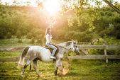 Woman getting ready for horseback riding — Stock Photo