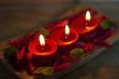 Red candles in spa salon — Stock Photo
