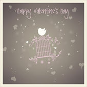 Love bird with birdcage and heart — Stock Photo