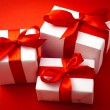 White gift box with red ribbon — Stock Photo #28751239