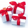 White gift box with red ribbon — Stock Photo #28751565