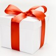 White gift box with red ribbon — Stock Photo #28751681