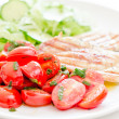 Fresh salad with chicken breast,lettuce and tomatoes — Stock Photo