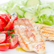 Fresh salad with chicken breast,lettuce and tomatoes — Stock Photo #28753321