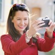 Beautiful smiling girl with camera — Stock Photo
