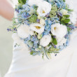 Bride with wedding bouquet — Stock Photo