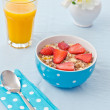 Breakfast with fresh muesli and orange juice — Stock Photo