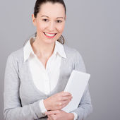 Businesswoman holding a laptop — Stock Photo