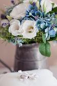 Golden wedding rings on small white cushion — Stock Photo