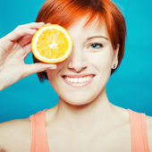 Healthy Lifestyle Woman holds orange — Stock Photo