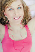Woman wearing headphones, listening to music — Stock Photo