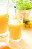 Glasses of orange juice and fruits — Stock Photo
