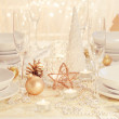 Gold Christmas table setting — Stock Photo #28760667
