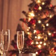 A decorated christmas dining table with champagne glasses  — Stock Photo