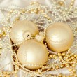 Christmas decoration on golden satin background — Stock Photo #28760985