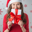 Christmas woman holding gifts wearing Santa hat — Foto de Stock