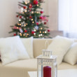 Lighted christmas tree in home — Stockfoto
