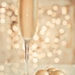 Glass of champagne against golden background — Stock Photo #28762643