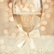 Glass of champagne against golden background — Stock Photo #28762659