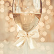 Glass of champagne against golden background — Stock Photo #28762661