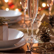 A decorated christmas dining table with champagne glasses — Stock Photo #28762967