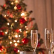 A decorated christmas dining table with champagne glasses  — Foto de Stock