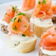 Canapes with smoked salmon and cream cheese — Stok fotoğraf