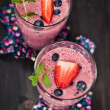 Strawberry and blueberry milkshake — Stock Photo #28764509